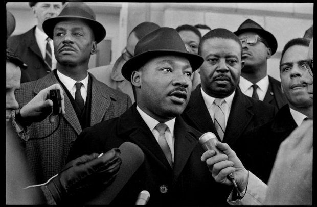 The Rev. Martin Luther King Jr. kicks off a voter registration drive at the Dallas County Courthouse in Selma, Ala., on Jan. 18, 1965, flanked by the Rev. Fred Shuttlesworth, left, the Rev. Ralph Abernathy and the Rev. Andrew Young. File photo by Ed Jones from The Birmingham News. (Ed Jones/The Birmingham News)