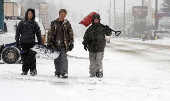 WEATHER19-- From left, Alex Myar, 12, Tristen Allen, 11, and Ebin McLaughlin, 11, walk around downtown Idaho Spring trying to finds work shoveling walk ways. So fare the boys have made ten dollars shoveling snow. Winter is going out like a lion today in much of Colorado, with snow fall and cold weather making its mark the day before spring arrives. RJ Sangosti/ The Denver Post  (Photo By RJ Sangosti/The Denver Post via Getty Images)